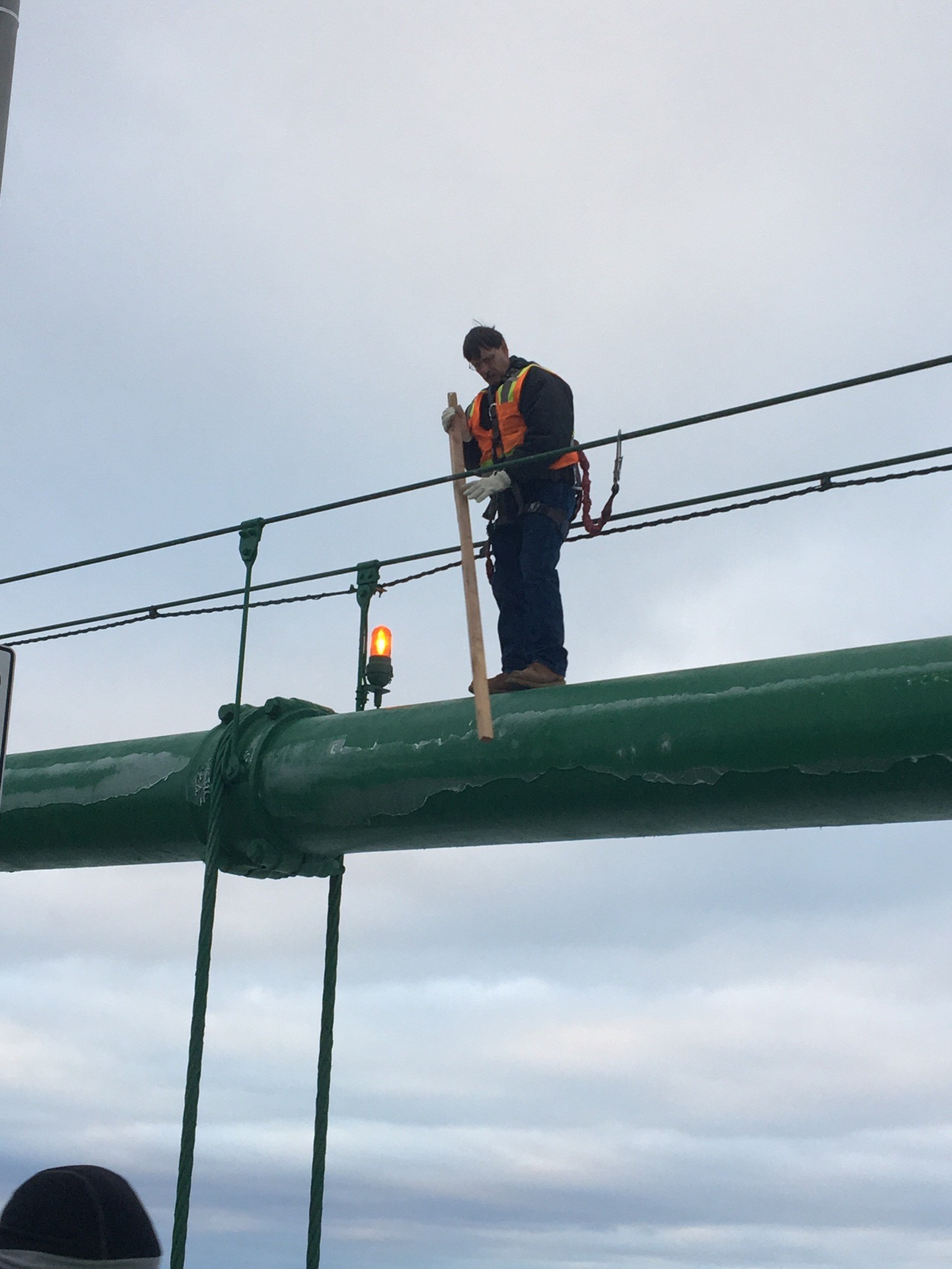 MBA steeplejack knocking ice off Feb. 25, 2018